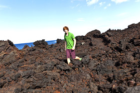 Boy in shorts volcano
